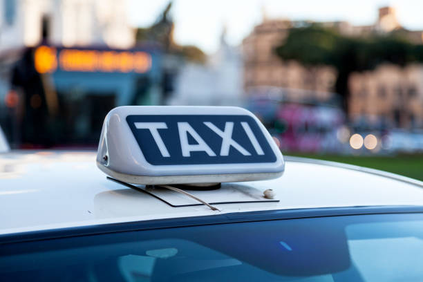 Roman taxi sign stock photo