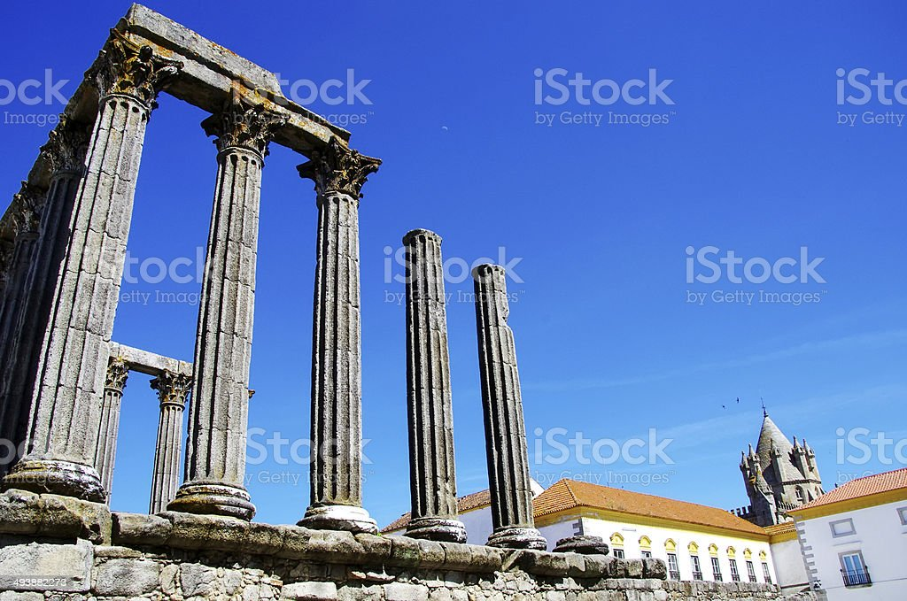 Roman temple and cathedral tower of Evora royalty-free stock photo