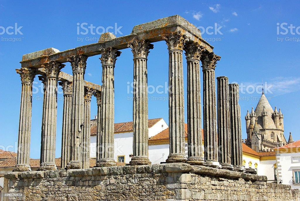 Roman temple and cathedral tower of Evora, Portugal. stock photo