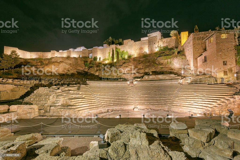 Roman theatre in Malaga, Spain at night Ruins of the Teatro Romano, on the west slope of the Alcazaba hill Alcazaba of Málaga Stock Photo