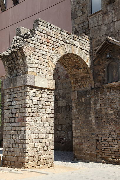 Roman wall and gate in Barcelona stock photo