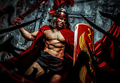 Roman warrior with muscular body fights