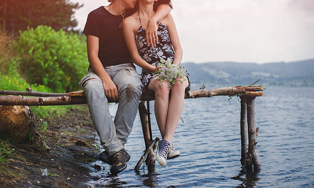 Romance by the lake A couple enyoing and relaxing by the lake. love at first sight stock pictures, royalty-free photos & images