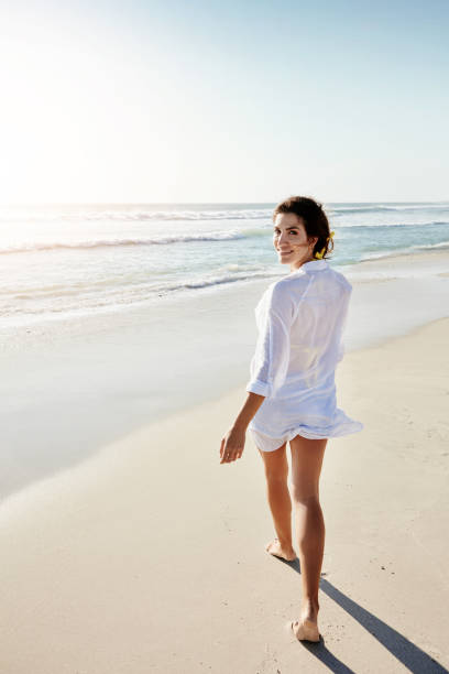 Romance me with walks on the beach stock photo