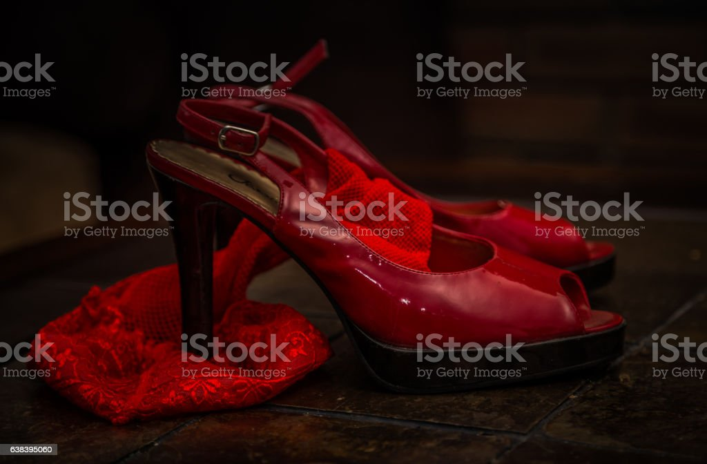 Romance with red shoes stock photo