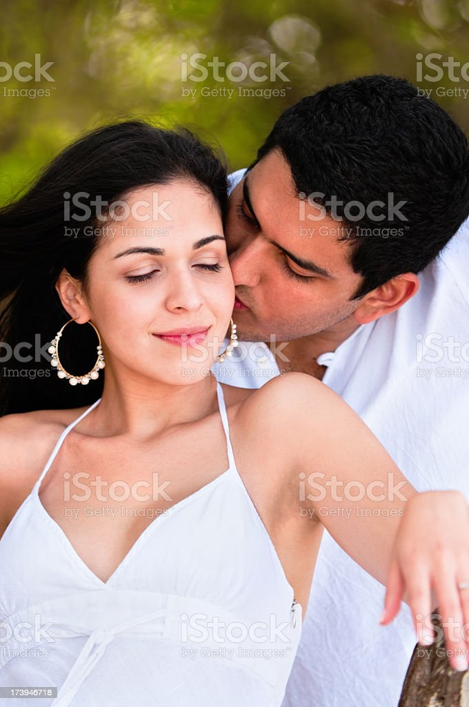 Romance - Young engaged couple flirting on a tropical beach royalty-free stock photo