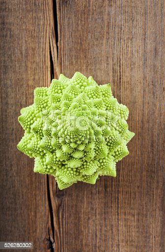 Romanesco broccoli cabbage (or Roman Cauliflower) on wooden background