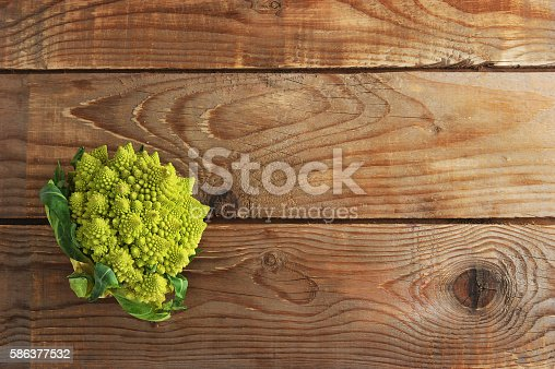 Romanesco broccoli, or Roman cauliflower on wooden background in rustic style. copyspace