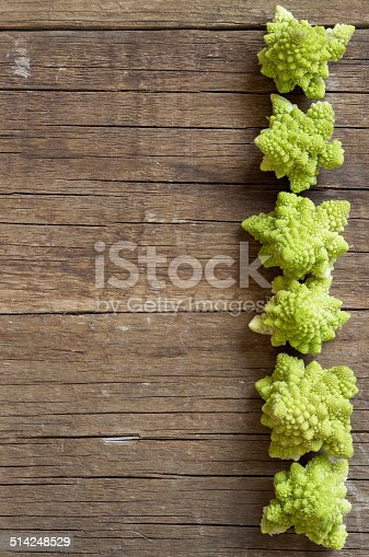 Romanesco cauliflower on a wooden table background