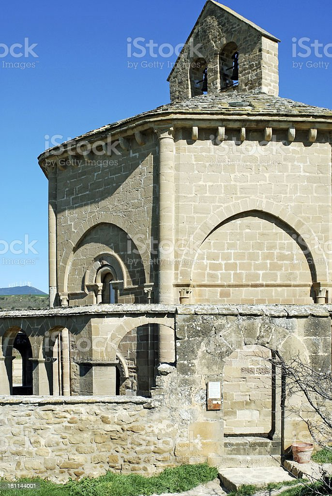 Romanesque church and wind turbines in rural northern Spain royalty-free stock photo