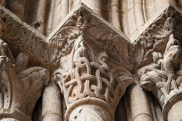 Romanesque column and carvings. stock photo