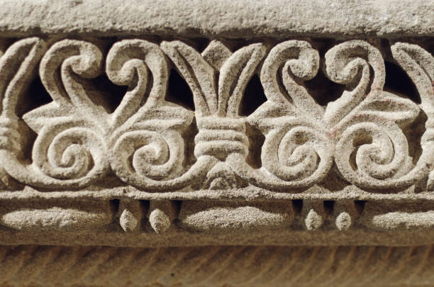 Romanesque decorations carved in the stone wall stock photo
