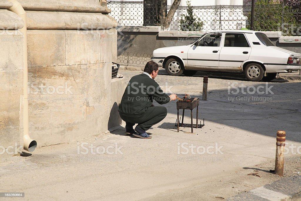 Romania: Bucharest Sidewalk BBQ royalty-free stock photo
