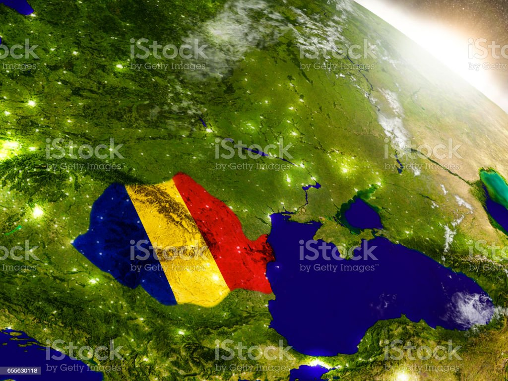 Romania with flag in rising sun stock photo