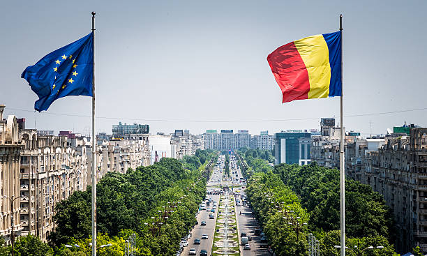 romanian and european union flag flying in bucharest, romania - romania stock pictures, royalty-free photos & images