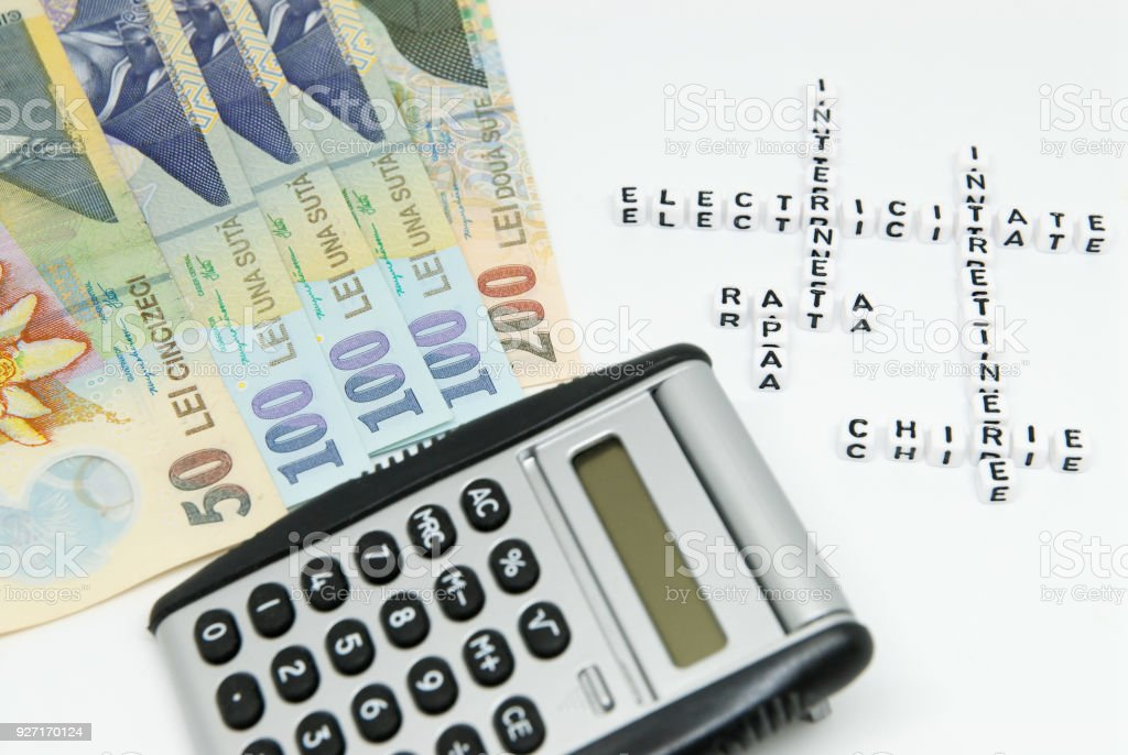 romanian currency leu ron and calculator and words written in romanian representing household monthly expenses concept photo stock photo