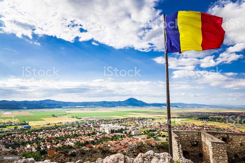Romanian flag flying above the town of Rasnov, Transylvania, Romania stock photo