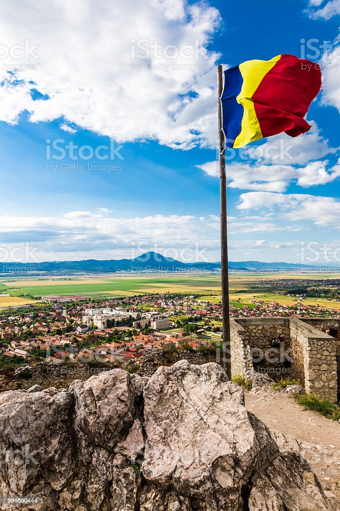 Romanian flag flying with magnificent Transylvanian landscape below stock photo