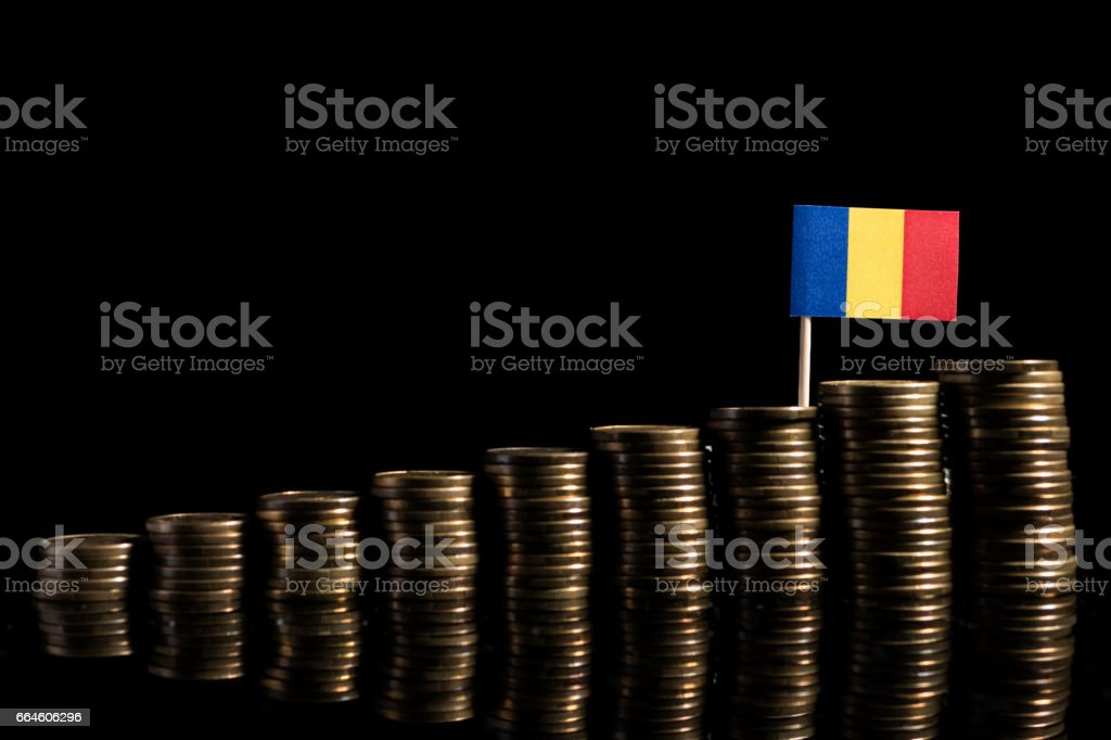 Romanian flag with lot of coins isolated on black background stock photo