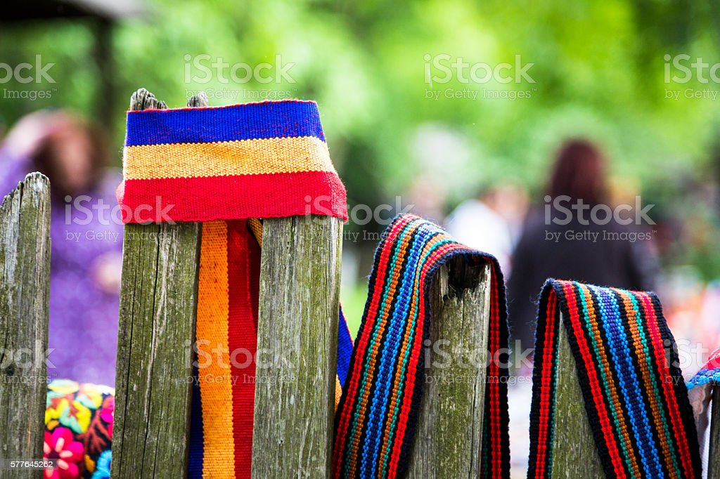 Romanian flag wrapped around a fence post stock photo