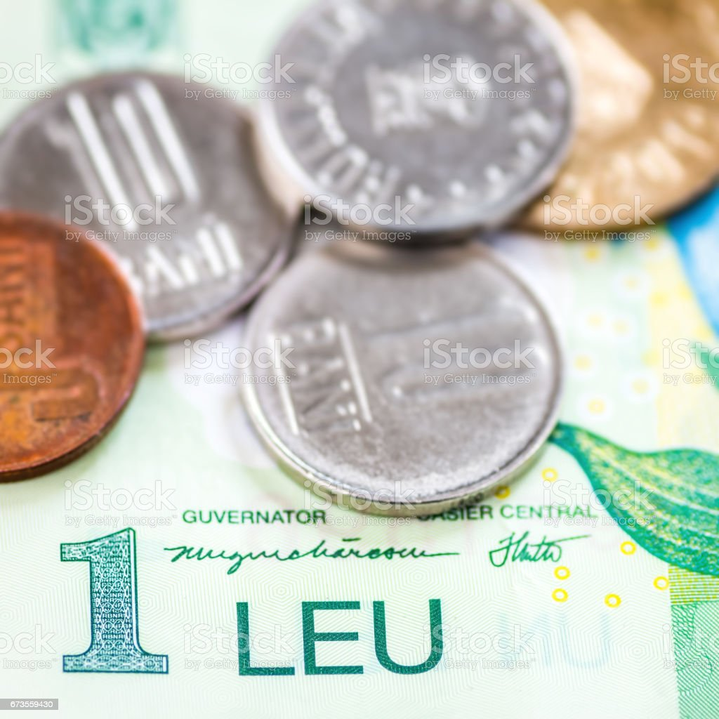 Romanian Leu currency close-up with one Leu banknote and multiple Bani coins royalty-free stock photo