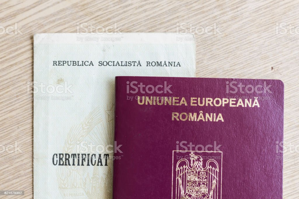 Romanian Passport and old birth certificate stock photo