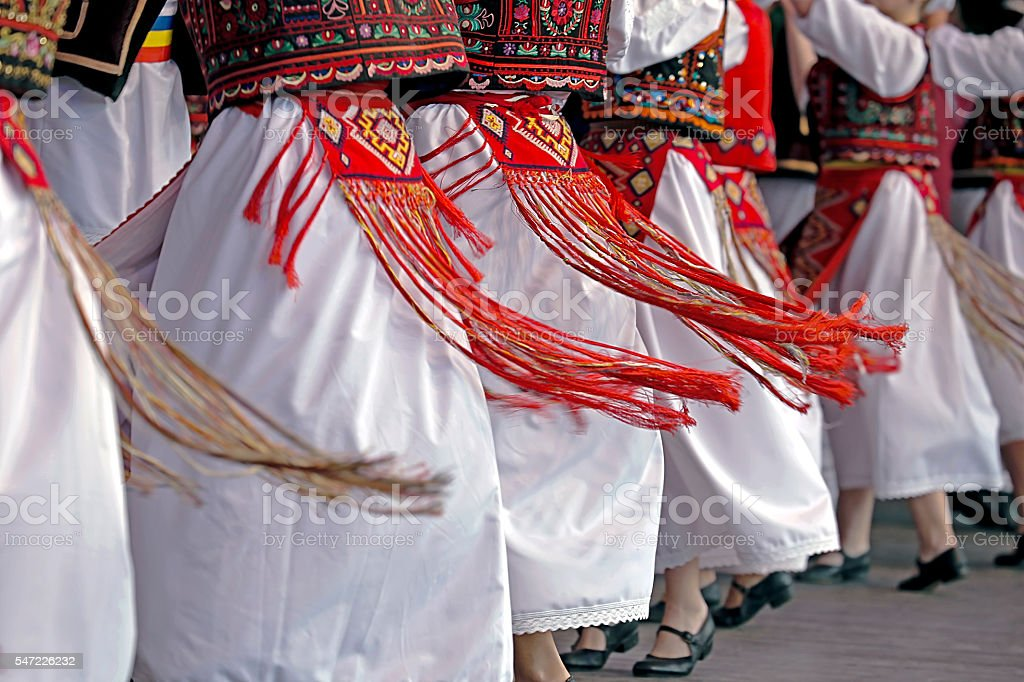 Romanian traditional dance with specific costumes stock photo