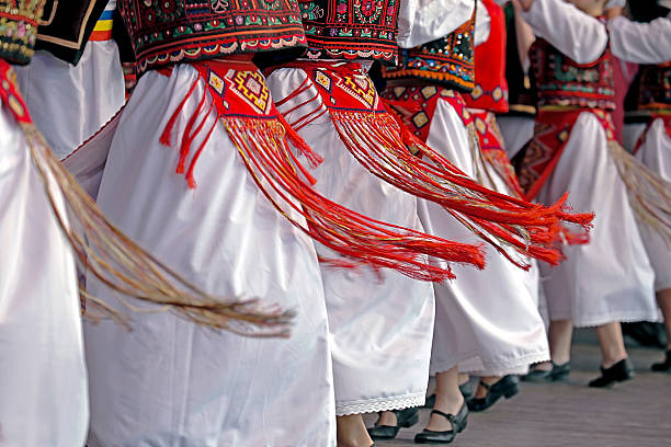 Romanian traditional dance with specific costumes Romanian dancers in traditional costume, perform a folk dance. folk music stock pictures, royalty-free photos & images