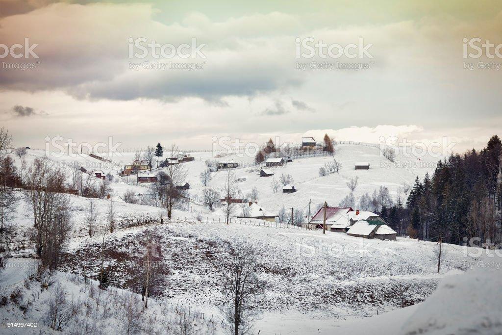 Romanian winter landscape in Carphatians Mountain.The rural winter landscape in the Bran area, Moeciu, Romania stock photo