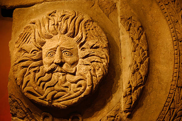 Romano-Celtic Gorgon's Head, Sun God, Roman Baths, Bath Part of the artifacts which is included in the Roman Bath, this stone etched Sun God (which is beleived to be a Gorgon) was uncovered in the ruins of the Roman Baths, during the period when the Roman Empire occupied the Roman Baths in Bath, England. This artifact It is still in the ruins of the Roman Bathhouse, a major tourist destination in the UK. roman baths england stock pictures, royalty-free photos & images