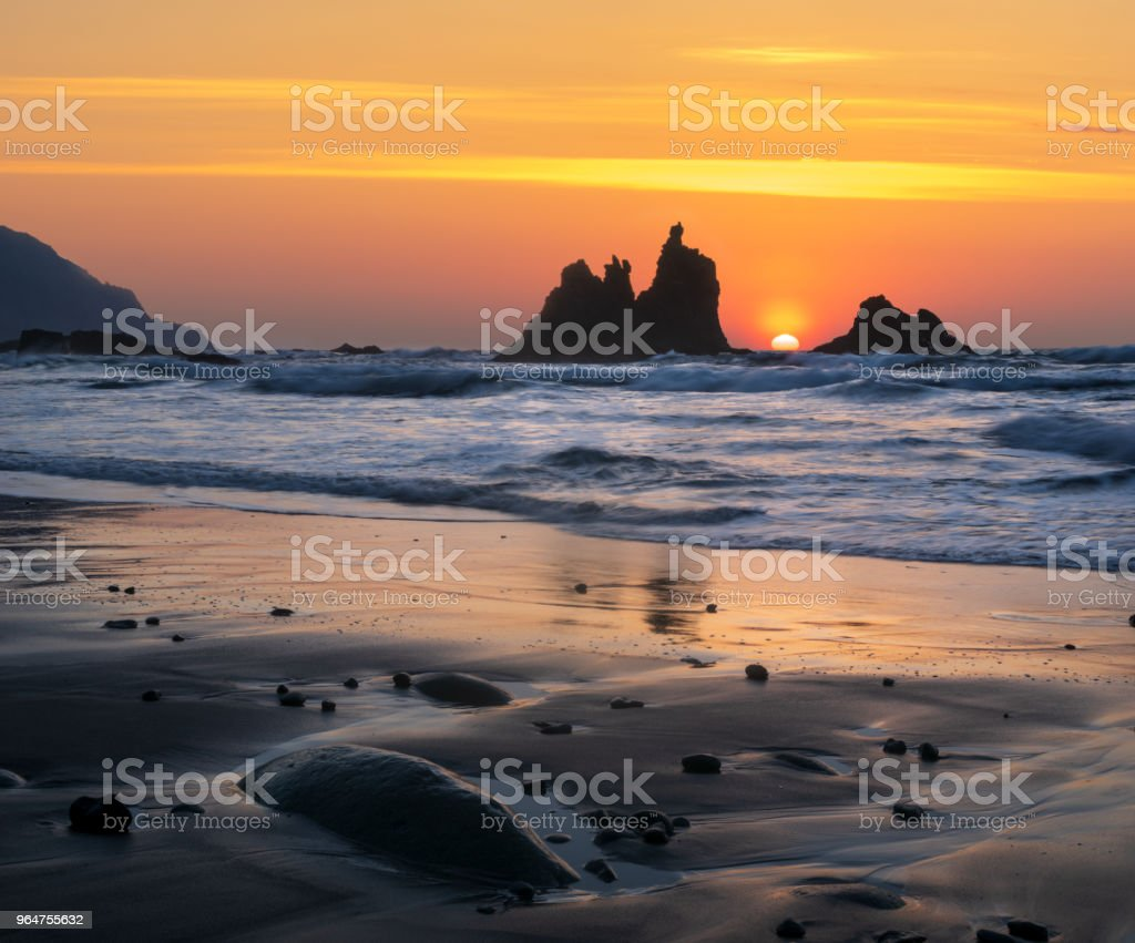 romantic and at the same time dramatic sunset on Benijo beach in tenerife royalty-free stock photo