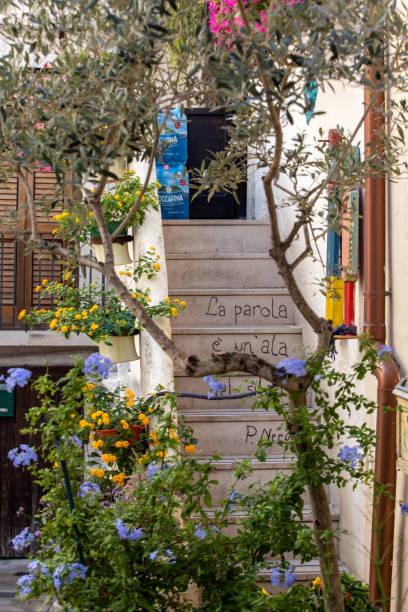 Romantic and evocative poems written on the walls and stairs of houses in Polignano a Mare. Apulia, Bari province, Italy, stock photo