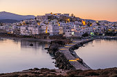 Romantic and peaceful scenery on greek town Naxos at dawn. Concept of tranquil, silence, magic, romantic place. Luxury travel destination.