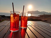 romantic appetiser red drink for two by the sea of Favignana