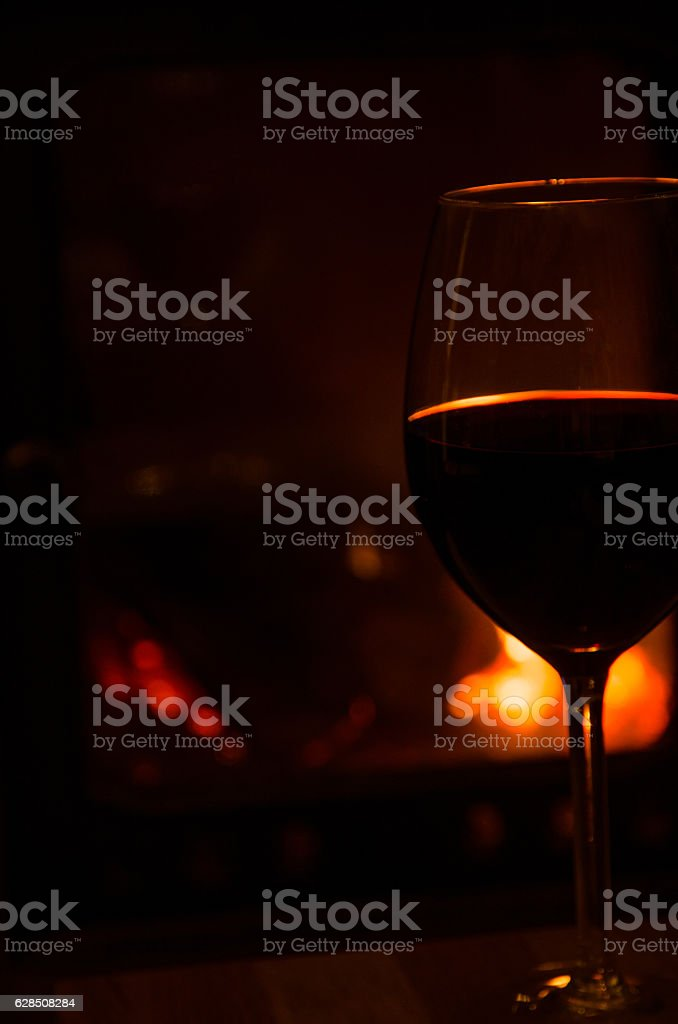 Romantic atmosphere with a glass of red wine stock photo