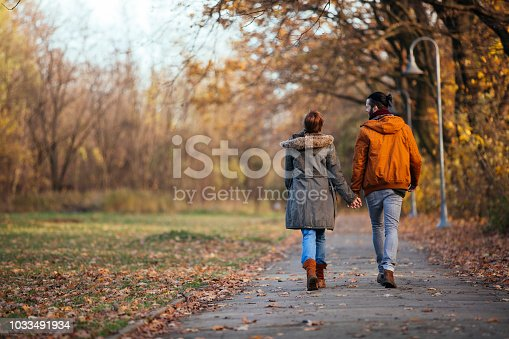 Romantic couple having a relaxing moments on their autumn walk