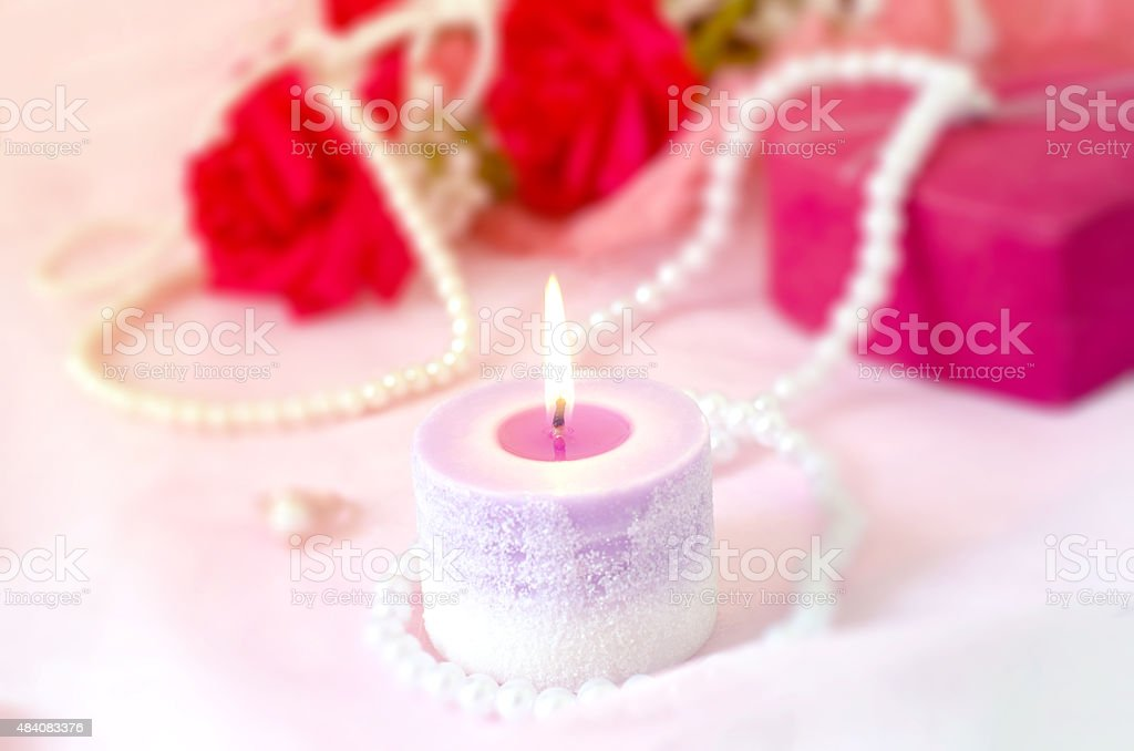 Romantic background - Aroma candle with red rose bouquet stock photo