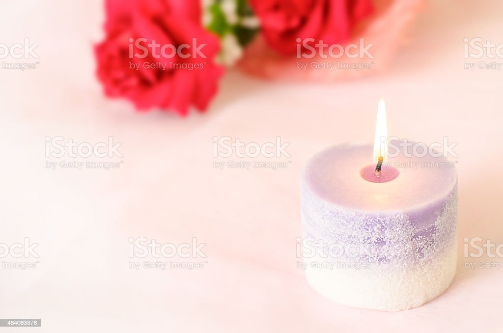 Romantic background - Aroma candle with red rose stock photo