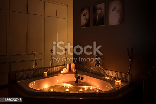 A bath tub with candlelights