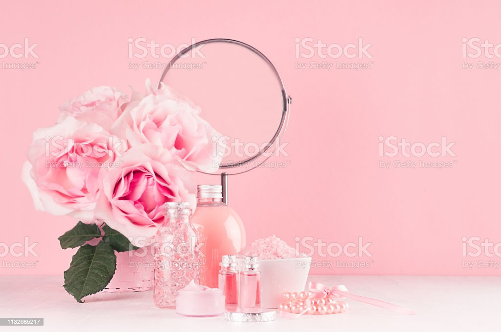 Romantic Bathroom Interior In Pastel Pink And Silver Color Flowers Round Mirror Bath Accessories Cosmetic Products Cream Salt Rose Oil Soap On White Wood Table Stock Photo Download Image Now Istock