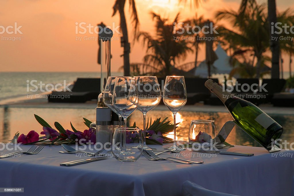 Romantic Beach Dinner by the Pool stock photo