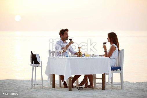 istock Romantic beach dinner 514104327