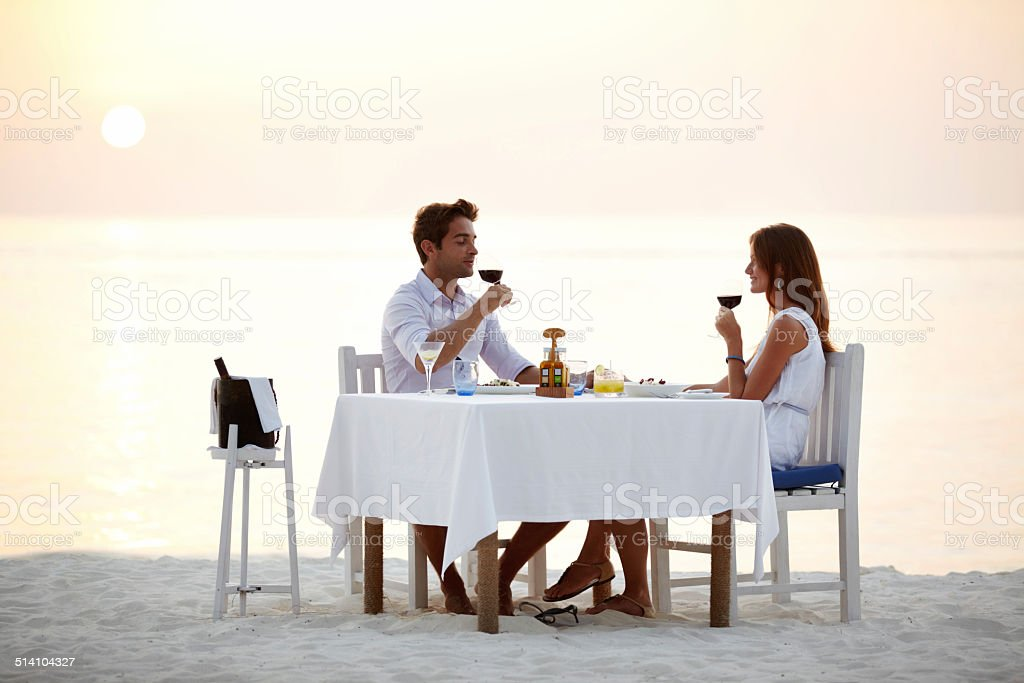 Romantic beach dinner stock photo