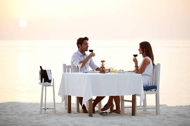 Romantic beach dinner stock photo