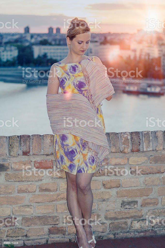 Romantic beautiful woman in sunset light sky stock photo