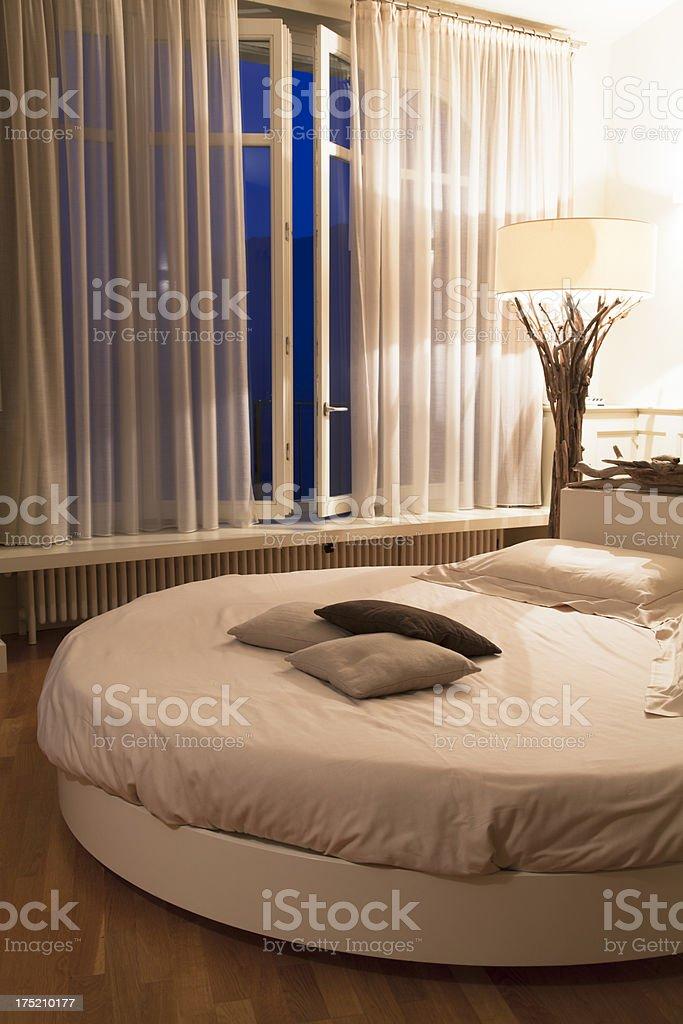 romantic bedroom by nightfall royalty-free stock photo