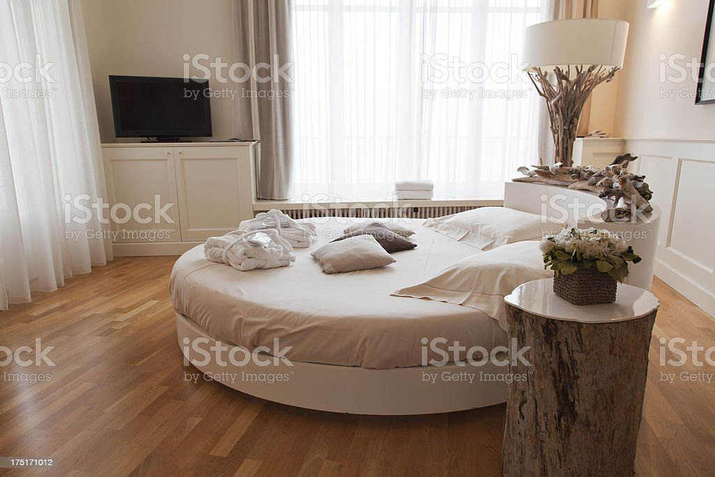 romantic bedroom with round bed stock photo