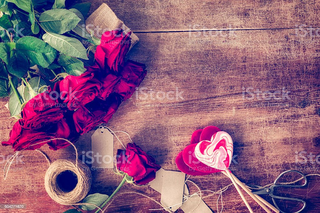 Romantic Bouquet of Red Roses and Heart Lollipops stock photo