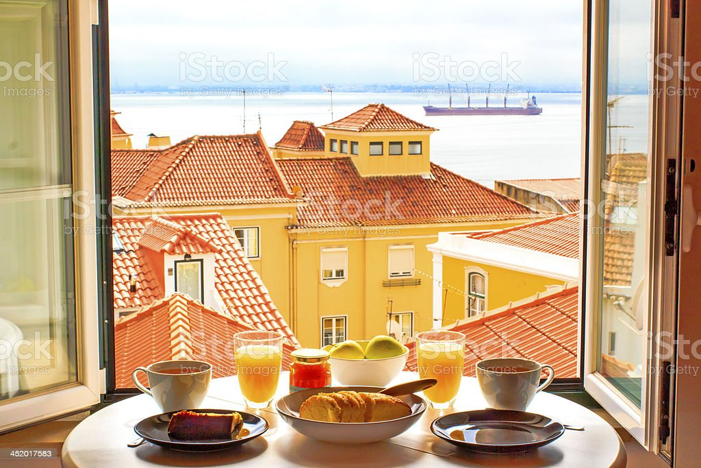Romantic breakfast by window stock photo