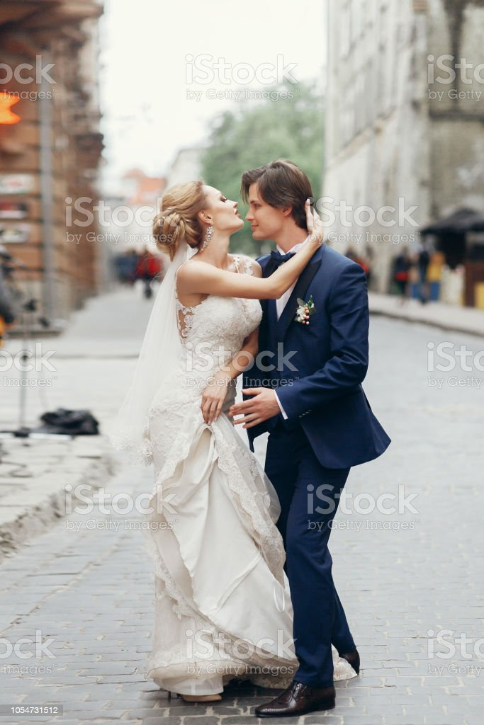 Romantic Bride And Groom Hugging Outdoors In Old European Street Newlywed Bride In White Wedding Dress In Sensual Embrace With Handsome Groom Couple Of Dancers Portrait Stock Photo Download Image Now